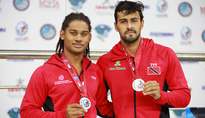 Christian Awah and Dylan Carter lef to right display their medals, rduring the XXX CCCAN Swimming Championships 2017, at the National Aquatic Centre, Couva. Carter sent a new CCCAN record in 52.73.