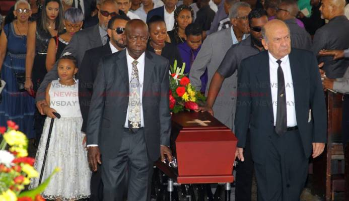Friends of the late sports journalist Dave Lamy former Fifa vice president Jack Warner (L) and Joe Hadeed (R) carry his casket at the end of Lamy's funeral, at the Holy Trinity Cathedral, Port of Spain. - ROGER JACOB